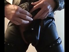 Horny Guy in leather jerking
