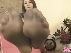 Supergirl takes off her boots and lets you play with her toes in pantyhose
