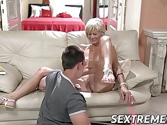 Horny granny enjoys riding together with sucking big young dick