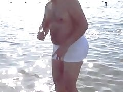 Daddy with Broad in the beam BUTT at the Beach