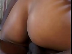 Alluring ebony chick with natural tits is jumping on huge black rod