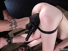 Chained redhead fucked with dick on a stick