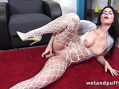 Brunette MILF in sexy bodystocking plays with toys