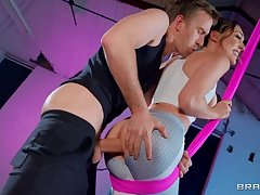 Powerfully built babe has her anus plowed hard in the gym