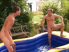 young boys playing in the garden