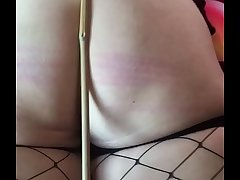 Caned the wife for being a bad girl